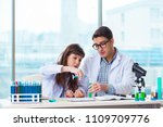 two chemists working in lab... | Shutterstock . vector #1109709776