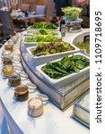 salad bar station in buffet line | Shutterstock . vector #1109718695