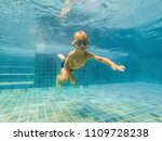 A Child Boy Is Swimming...