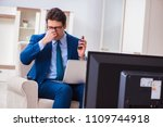 businesman watching tv in office | Shutterstock . vector #1109744918