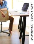young woman sitting at office... | Shutterstock . vector #1109757695