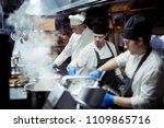 group of chefs working in the... | Shutterstock . vector #1109865716