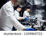 group of chefs working in the... | Shutterstock . vector #1109865722