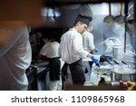 group of chef preparing food in ... | Shutterstock . vector #1109865968
