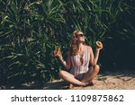 young woman with papaya during... | Shutterstock . vector #1109875862
