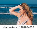 portrait of woman on the beach... | Shutterstock . vector #1109876756