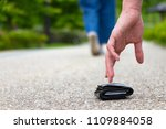 a scene to pick up a wallet | Shutterstock . vector #1109884058