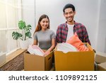 asian young couple carrying big ... | Shutterstock . vector #1109892125