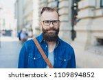 young bearded man wearing... | Shutterstock . vector #1109894852