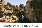 an arch in the sea between the...   Shutterstock . vector #1109914862