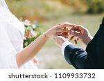 the groom wears the bride a...   Shutterstock . vector #1109933732