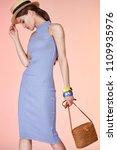 sexy brunette woman wear skinny ... | Shutterstock . vector #1109935976