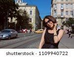classy smiling model wearing...   Shutterstock . vector #1109940722