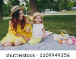 laughing woman in yellow dress... | Shutterstock . vector #1109949356