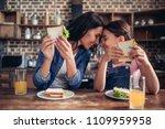 caucasian mother and daughter... | Shutterstock . vector #1109959958