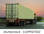 Small photo of Truck on highway road with container, transportation concept.,import,export logistic industrial Transporting Land transport on the asphalt expressway with sunrise sky