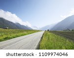 empty road to mountains. view... | Shutterstock . vector #1109974046