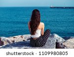 pretty alone girl sit on the... | Shutterstock . vector #1109980805
