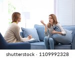 female psychologist with client ... | Shutterstock . vector #1109992328
