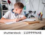 focused preteen boy doing... | Shutterstock . vector #1109999648