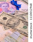 dollars and hryvnia banknotes... | Shutterstock . vector #1110012968