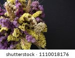 statice flowers on black stone... | Shutterstock . vector #1110018176
