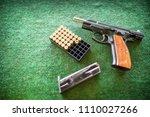 handgun with ammunition on a...   Shutterstock . vector #1110027266