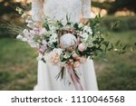 a girl in a white wedding dress ... | Shutterstock . vector #1110046568