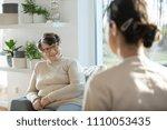 happy elderly woman relaxing at ... | Shutterstock . vector #1110053435