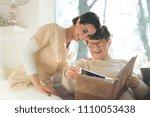 smiling senior woman watching... | Shutterstock . vector #1110053438