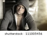 cool young guy in hooded jacket | Shutterstock . vector #111005456