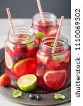 summer berry lemonade with lime ... | Shutterstock . vector #1110069302