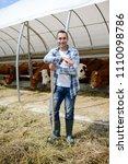 portrait of handsome farmer in...   Shutterstock . vector #1110098786