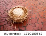 Straw Hat Over A Red Brick...