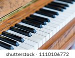 the old wooden piano keyboard... | Shutterstock . vector #1110106772