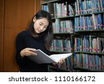 asian students reading books in ... | Shutterstock . vector #1110166172