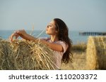 happy young woman by sunset... | Shutterstock . vector #1110203372