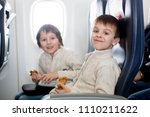 two children  eating sandwiches ... | Shutterstock . vector #1110211622