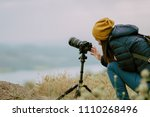 young woman shooting with...   Shutterstock . vector #1110268496