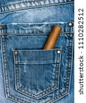 pocket of jeans staffed with... | Shutterstock . vector #1110282512