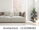 white room with sofa and winter ... | Shutterstock . vector #1110288482