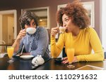 young couple drinking coffee... | Shutterstock . vector #1110291632