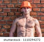 builder with muscular torso and ... | Shutterstock . vector #1110294272