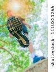 running feet male view from...   Shutterstock . vector #1110321266