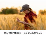a woman farmer examines the...   Shutterstock . vector #1110329822