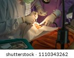 the doctor cleaning the teeth... | Shutterstock . vector #1110343262
