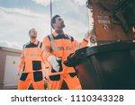 two garbagemen working together ... | Shutterstock . vector #1110343328