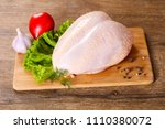 raw chicken breast with skin | Shutterstock . vector #1110380072