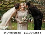 bride and groom kiss mom's... | Shutterstock . vector #1110392555