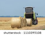 Tractor And Round Baler...
